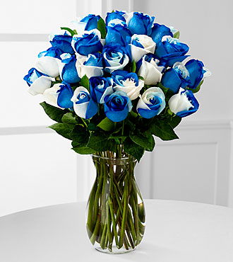 big beautiful blue vase of blue  flowers