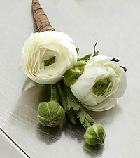 The FTD ® White Ranunculus Boutonniere