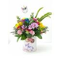 Rainbow arrangement with unicorn vase