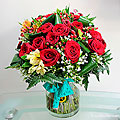 Red roses & Seasonal Flowers in vase